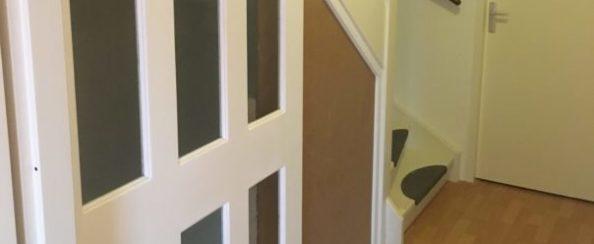 Foto van schuifdeur voor een trap